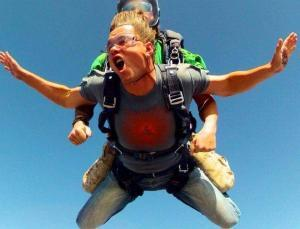 Skydiving in our Buddha design on a men's crew neck t-shirt in indigo