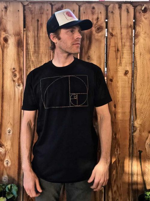 Golden Ratio design on a mens crew neck t-shirt in black. The design is made from tiny, positive quotations about the connection between Phi and the universe!