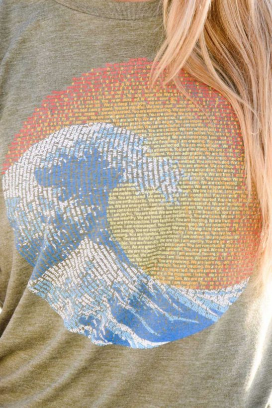 great wave yin yang design made of affirmations on aflowy shirt with rolled up sleeves - closeup product image