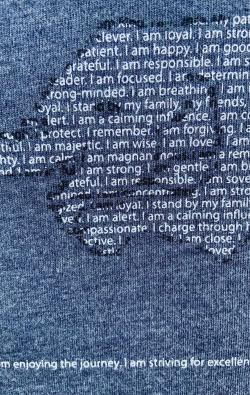 super closeup image of Think Possible Apparel's yoga elephant affirmations design screen printed on a navy shirt