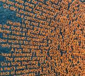 super closeup image of Think Possible Apparel's buddha quotes design screen printed on a indigo shirt