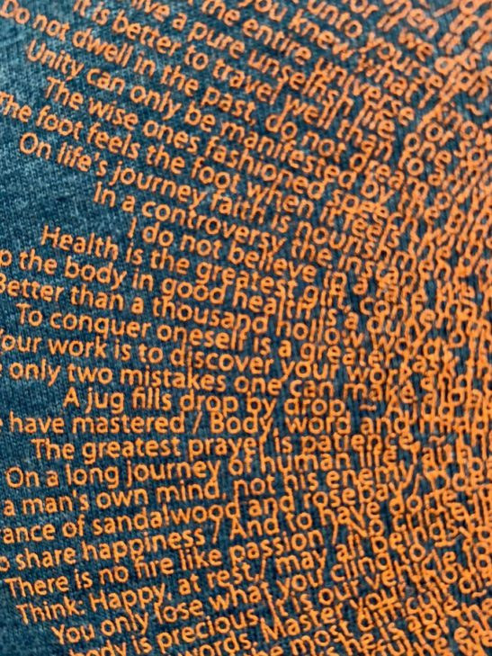 super closeup image of our buddha quotes design by Think Possible Apparel