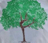 closeup image of Think Possible Apparel's dancing tree affirmations design screen printed on a white shirt