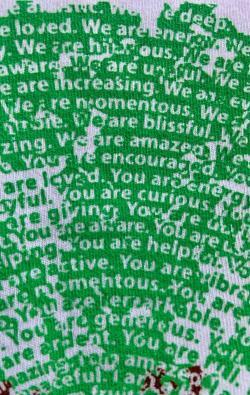 super closeup image of Think Possible Apparel's dancing tree affirmations design screen printed on a white shirt