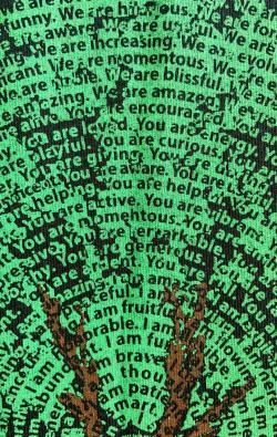 super closeup image of Think Possible Apparel's dancing tree affirmations design screen printed on a black shirt