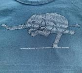 closeup image of Think Possible Apparel's yoga elephant affirmations design screen printed on a indigo shirt