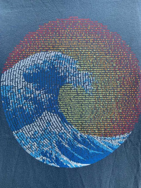 great wave design screen printed on a men's crew neck organic cotton t-shirt in pacific blue - closeup product image