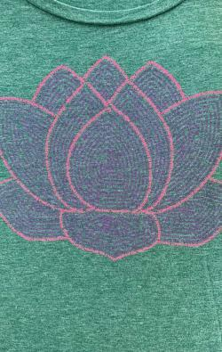 closeup image of Think Possible Apparel's lotus flower quotes design screen printed on a forrest green shirt