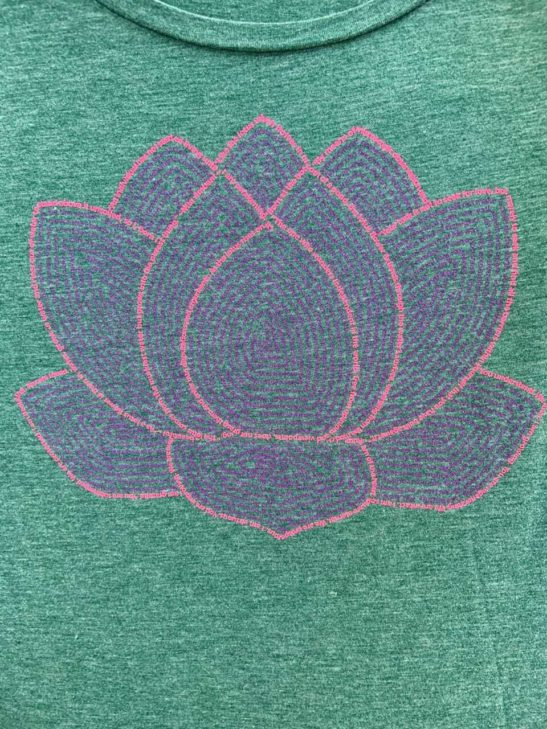 lotus flower quotes and affirmations screen printed on a women's scoop neck flowy shirt - featured product image - closeup product image