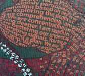 super closeup image of Think Possible Apparel's octopus brain affirmations design screen printed on a slate shirt