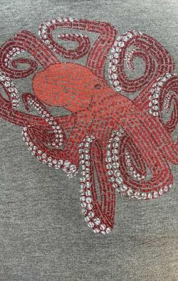 closeup image of Think Possible Apparel's octopus brain affirmations design screen printed on a gray shirt