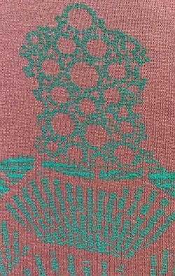 super closeup image of Think Possible Apparel's turtle affirmations design screen printed on a mauve shirt