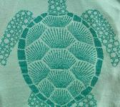 closeup image of Think Possible Apparel's turtle affirmations design screen printed on a mint shirt