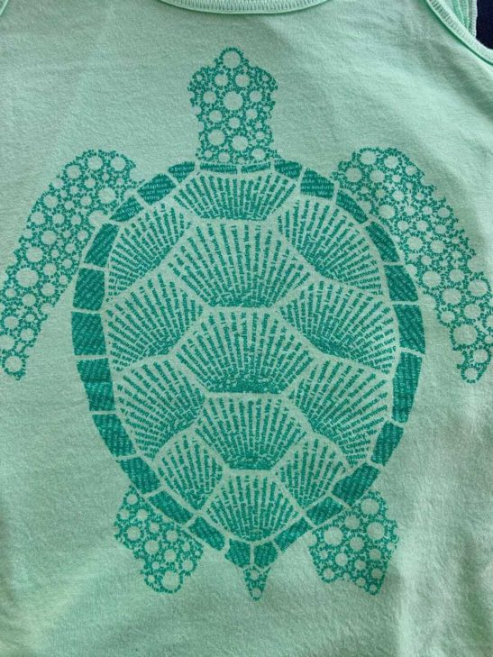 Our turtle design is built from affirmations and screen printed on a super soft flowy racerback tank top - closeup product image