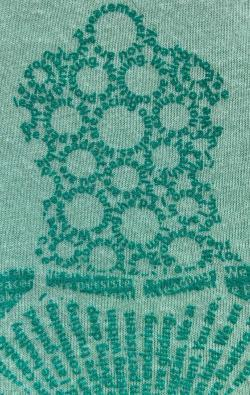 super closeup image of Think Possible Apparel's turtle affirmations design screen printed on amint shirt