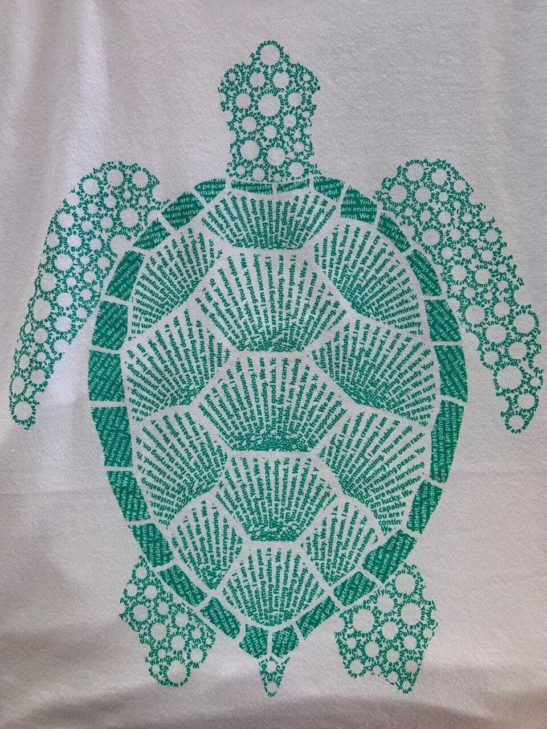 Our turtle design is made entirely from affirmations about the meaning of the turtle & screen printed on a scoop neck flowy shirt. - closeup product image