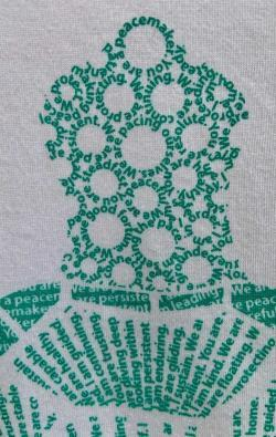 super closeup image of Think Possible Apparel's turtle affirmations design screen printed on a white shirt