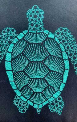 closeup image of Think Possible Apparel's turtle affirmations design screen printed on a black shirt