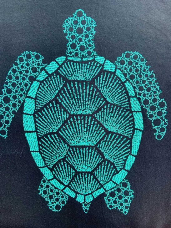 turtle affirmations design screen printed on a men's crew neck shirt - closeup product image