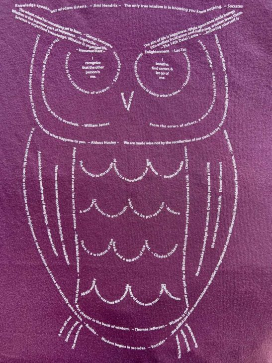 Our wise owl design is completely made from quotes and is screen printed on a scoop neck flowy shirt. - closeup product image