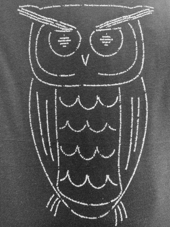 Our wise owl design made from wisdom quotations and screen printed on an organic bamboo and organic cotton flowy dolman sleeve tee - closeup product image