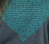 closeup image of Think Possible Apparel's heart quotes design screen printed on a dark gray heather shirt