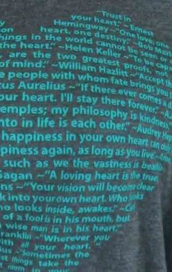 super closeup image of Think Possible Apparel's heart quotes design screen printed on a dark gray heather shirt