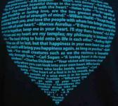 closeup image of Think Possible Apparel's heart quotes design screen printed on a black shirt