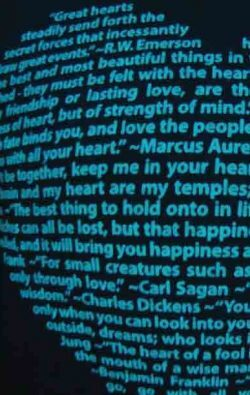 super closeup image of Think Possible Apparel's heart quotes design screen printed on a black shirt