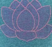 closeup image of Think Possible Apparel's lotus flower quotes design screen printed on a denum shirt