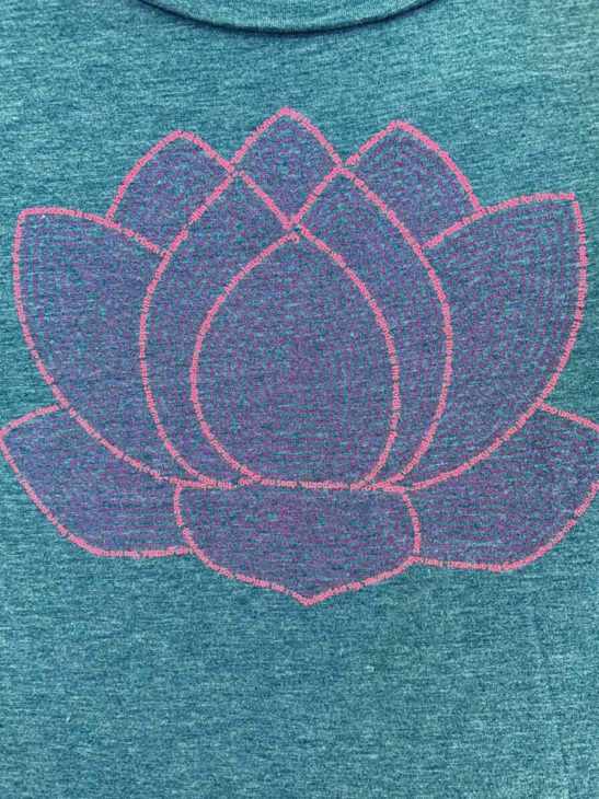 This lotus flower design is made completely from quotes and affirmations and is screen printed on a women's flowy muscle tank - closeup product image