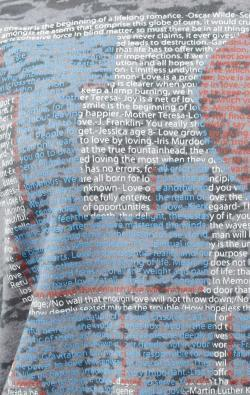 super closeup image of Think Possible Apparel's love quotes design screen printed on a gray shirt