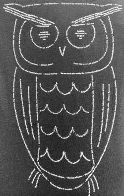 closeup image of Think Possible Apparel's wise owl quotes design screen printed on adark gray shirt
