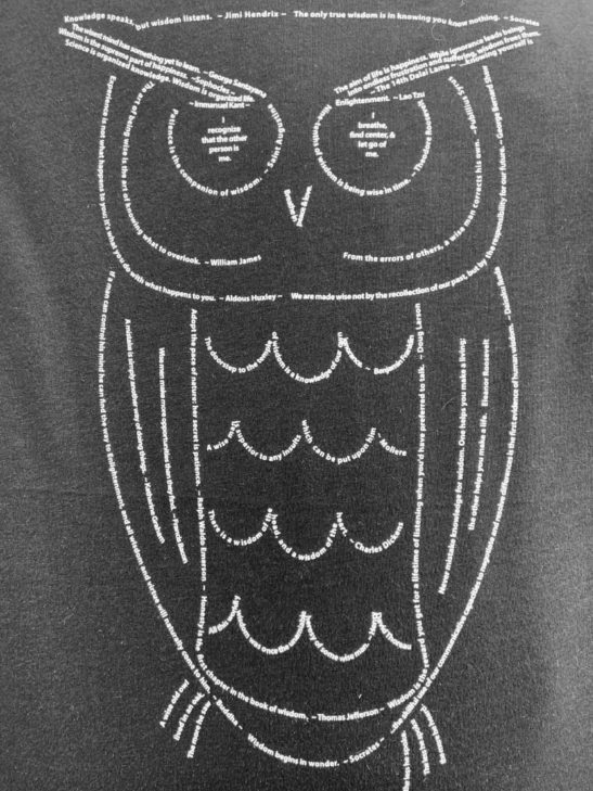 Our Owl design is made completely from quotes about wisdom and screen printed on this fabulous flowy long sleeve off shoulder tee - closeup product image